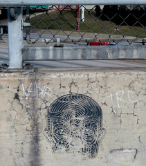 Untitled (iamajellydonut) Tags: streetart chicago black face concrete stencil zor