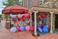 WDW Sept 2012 - Wandering through Liberty Square (PeterPanFan) Tags: 2012 america autumn canon canoneos5dmarkiii disney disneyparks disneyworld fl fall florida libertysquare mk magickingdom merchandisecart merchandisestand orlando parasols sept september travel usa unitedstates unitedstatesofamerica vacation wdw waltdisneyworld