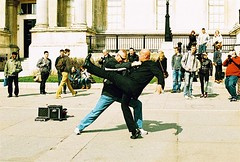 Roll 2 - Insert Clip-Art Kapow Here (Cris Ward) Tags: street camera old city uk orange streets color colour slr london film yellow matrix rollei analog 35mm vintage daylight frozen movement lomo xpro lomography warm artist cross britain crossprocess grain trafalgarsquare posing slide retro crossprocessing april analogue manual noise performer processed e6 yashica highspeed blown colorshift lsi c41 2013 yashicafxd colorreversal cr200 lomolab digibase rolleidigibasecr200