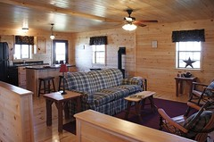Great room in Musketeer log home