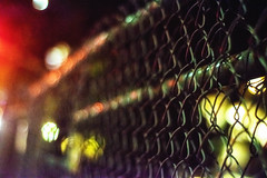 "Fency - ""new"" 50 AIS (pillarsoflight) Tags: portland pdx oregon city pnw beauty apsc crop sensor nikon d3300 50mm 18 ais filmlens classicaperture prime lightroom adobe shotonsandisk sandisk apple imac pacificnorthwest nik lights bokeh night 23rd fence metal rungs pattern cross red yellow green blue reflection noise grain pitchblack colorefex"