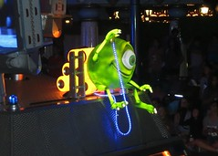 Mike from Monsters Inc in the Paint the Night parade (Ruth and Dave) Tags: mike monster disneyland disneylandresort anaheim character monstersinc disney movie green oneeyed cyclops animated parade illuminated paintthenight