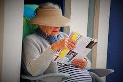 Sous le soleil, sous le soleil (2) (dominiquita52) Tags: streetphotography women femme hat chapeau book magazine stripes letouquet