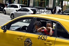 The Curiosity of Cab 6450 (draketoulouse) Tags: chicago loop street streetphotography randolph color nikon taxi cab sidewalk children yellowcab outdoor outside city urban downtown