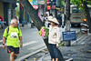 A tourist checking out a flower seller on the streets of Hanoi, Vietnam (Ormastudios) Tags: oldquarter hanoi vietnam love oldman flowerseller vietnamese hat streetshot