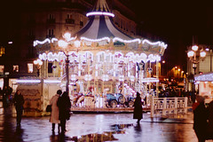 (voldy92) Tags: light paris france rain night dark merrygoround carrousel hteldeville