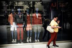escapee. (buckyishungry) Tags: road street blue red orange woman mannequin colors fashion yellow dark clothing singapore fuji escape candid orchard clothes fujifilm handbag fujinon palette orchardroad x100 armanijeans