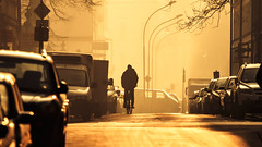 Alternative traffic [ Explored ] (Ryskatt) Tags: street morning bike bicycle fog haze widescreen streetphotography poland krakow 169 cracow canoneos30d krakoff canonef70200mmf4usm