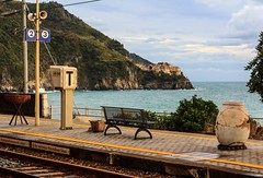The Train Station With The World's Best View? Corniglia in Cinque Terre Italy (Maria_Globetrotter) Tags: world italien pink autumn sea italy heritage beautiful architecture canon site amazing fantastic october colorful europe italia day cloudy unesco stunning rough lovely mundial picturesque cultural hst itlia 2012 itali whs corniglia bello  patrimonio italya  welterbe tala wochy 550d 1585 werelderfgoed dellumanit vrldsarv werelderfgoedlijst verdensarven weltkulturerb itali mariaglobetrotter