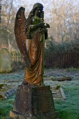 Otterbourne angel (Skink74) Tags: uk morning flowers england 20d monument cemetery grave statue stone angel early wings memorial frost hampshire canoneos20d memory gravestone churchyard otterbourne nikkor35f14 nikkor35mm114ai