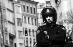 Policeman (ManuEnero) Tags: santiago españa canon de spain police bn personas galicia compostela l strike policia demostration policeman manifestación parlamento huelga miradas gallego ccoo educación 50d ciudadanos