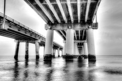 The Bridge (Dean Whitehurst) Tags: ocean longexposure travel bridge winter light sea blackandwhite seascape beach nature lines canon evening coast landscapes waves unitedstates o outdoor dusk pov availablelight tide shore virginiabeach atlanticocean architecturalphotography chesapeakebaybridgetunnel canon1022mm thechesapeakebay canon7d deanwhitehurst