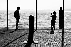Lazise (gian2374) Tags: people italy lago garda bianconero controluce lazise