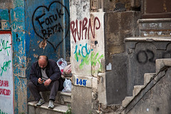 A man sitting in the doorway of a run-down building in the Galata Quarter, Istanbul. (cookiesound) Tags: life street trip travel people inspiration man building travelling architecture canon turkey photography graffiti reisen sitting fotografie homeless documentary istanbul adventure doorway journalism galata travelphotography traveldiary rundownbuilding reisefotografie traveljournalism travelphotographers cookiesound nisamaier ulrikemaier ullimaier galataquarter mansittingindoorway maiermaier reisefotografen