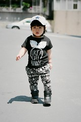 I am going for my breakfast. (Zorie Huang) Tags: light portrait baby cute girl canon asian kid infant child boots innocent taiwan cap lovely taiwanese oneyearold littlerocker streetsnap zorie nikeboots kidinacap