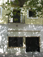 faade (Ladybadtiming) Tags: windows light shadow house building tree leaves yellow spain play squares spots faade portbou rambla ombreetlumire platanes