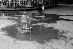(nVa17) Tags: puddle child childhood childhoodmemories kid game wash kickscooter summer city urban perm       fujifilmxt1 53mm fujifilm street streetphoto streetphotography blackandwhite blackwhite blackandwhitephotography bnw bw