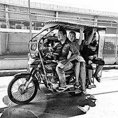 Hanging on.... (tomk630) Tags: manila tricycle morning commuters motorized hangingon transportation bw