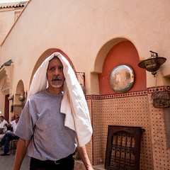 Protection from the heat @ Marrakech medina (PaulHoo) Tags: heat warm medina marrakech squareformat 2015 marocco lumix red souk streetphotography men character face streetcandid candid sorrow expression protection sun warmth weather