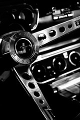 Mustang Interior (Jade Chanoquaway) Tags: nikon nikkor d5500 blackandwhite black white grey gray grayscale greyscale bw contrast light shadow monochrome silhouette shadows reflection reflections industrialmachinery machine machines window windowscement concrete pavement asphalt car auto automobile wheel steering chrome dials shifter gearshift ford mustang convertible horse texture pattern september canada ontario circles dial