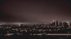 Foggy Austin (ashpmk) Tags: austin skyline skyscraper night nightphotography fog foggy lighttrails texas texascapitol