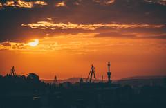 Sunrise in Gothenburg (freyavev) Tags: gothenburg gteborg schweden sweden sverige crane cranes port silhouettes layers vsco orange clouds sun sunrise city view sky urban urbansunrise
