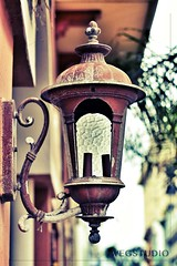 Illuminating! (wegstudio) Tags: architecture buildings dof oldsanjuan puertorico details depthoffield lamps oldbuilding viejosanjuan uploaded:by=flickrmobile flickriosapp:filter=chameleon chameleonfilter