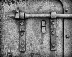 Metal (jayvan) Tags: ca bw iron rusted bodie corroded sonya77 doorthingy