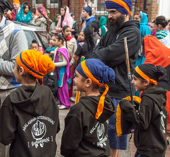 Young members of a Sikh martial arts organisation await the start of the 2013 Vaisakhi festival parade in Southampton (Anguskirk) Tags: uk england color colour festival martialarts hampshire procession sikh gurdwara southampton turbans saris vaisakhi 2013 nagarkirtan gurdrawananaksar akalakharainternational