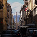 View up a street of Turin, with the Alps as the end point