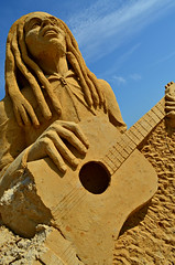The sands of time (Bob Marley in sand) (Di's Free Range Fotos) Tags: uk england rain weather sussex sand brighton time decay east jamaica reggae jamaican rasta sandsculpture bobmarley redemption crumbling blackrock cracking timewilltell jamaicanmusic rastaman sandsculpturefestival nothinglasts reggaesuperstar reggaeicon