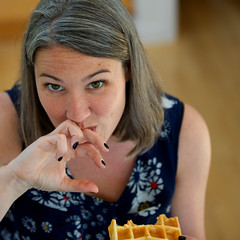 Waffling (Andrew R. Whalley) Tags: portrait woman kitchen girl lady eating sticky fingers waffle stickyfingers