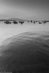 Calmness (s1nano) Tags: sea blackandwhite bw seascape boats boat places calm calmness nikond60 nikkorafsdx1855mmf3556gvr