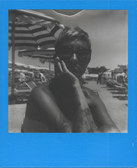 Summer people (ale2000) Tags: blue summer portrait people bw woman beach face analog donna seaside estate arm 600 portraiture instant analogue azzurro ritratto spiaggia viso visage impossible braccio i1 instantphotography analogico manualexposure hardcolor