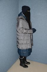 Two Coats (Buses,Trains and Fetish) Tags: slave torture girl niqab hijab burka chador sweat waitress maid fur anorak coat winter warm apron