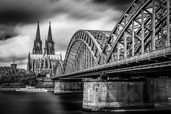 Cologne 2 (karol_sobotka) Tags: cologne river bridge church dom catedral bw longexposure water time monochrome architecture blackandwhite depth field serene skyline outdoor photo border sky