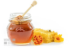 Jar of fresh honey (wdnetstudio) Tags: honey honeycomb isolated white comb sweet beeswax closeup healthy yellow food propolis wax fresh natural gold dipper nature wooden orange organic portion drizzler cell studio brown health liquid golden close nutrition bee honeyed wood beauty breakfast product drop translucent dripping ingredient spoon pollen flowers honeydew jar d750