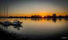Sunset on Fraser river  (T.ye) Tags: sunset river fraser outside landscape boat outdoor water orange light sun waterfront dusk sky sea serene pier seasied shore beach seaside todd ye