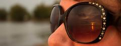 Twin suns (sloansquared) Tags: sunglasses sun sunset dusk reflection woman viewing lake lakeshore waterfront lakeontario beach