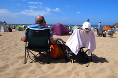 Bit warm love ! (chrisnormandale) Tags: hot couple summer beach chairs sunbathing coast ricoh grd4 wwwchrisnormandalecom street pphotography 28mm vivid colour