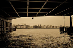 Under the bridge (unluonur) Tags: sepya sepia amsterdam europe bridge water dark city structure steel construction river canal