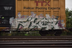FIXER (TheGraffitiHunters) Tags: graffiti graff spray paint street art colorful freight train tracks benching benched fixer boxcar
