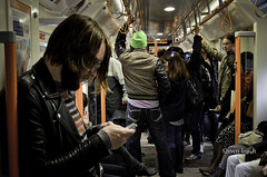 Going Overground (Sven Loach) Tags: uk winter england orange london leather mobile youth train cool nikon phone britain candid hats streetphotography jacket headphones hackney hip wooly jackets overground dalston crowded reportage eastlondon iphone tfl d5100