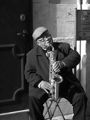 Sax player (Baz 120) Tags: street portrait blackandwhite bw italy faces candid streetphotography unposed g3 45mm decisivemoment candidportrait mft primelens candidstreet
