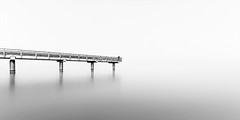 bridge #2 (sebileiste) Tags: bridge sea white black nikon long exposure 10 sigma baltic 20 brcke lbeck weiss ostsee belichtung schwarz timeless travemnde glatt holstein schleswig zeitlos langzeit d90