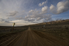 Thirty Five to Oakley (Teacozy Design & Photography) Tags: road sign rock clouds creek fence spring nikon idaho adventure climbing dirt granite birch miles 20mm 35 gravel oakley d3 cityofrocks