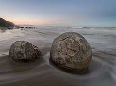 Crazy Boulders (ajecaldwell11) Tags: sunset sea newzealand sky stone clouds day dusk clear otago morerakiboulders