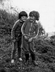 Can we go in the river (theirhistory) Tags: boy grass river child boots bank trousers wellies tracksuit plimsolls