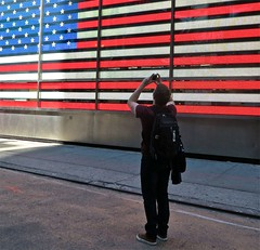 Tourist, NYC (Timbo_a_go_go) Tags: camera square stars photography stripes flag illuminations tourist times owen
