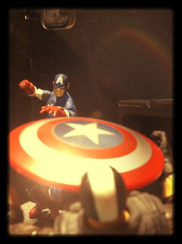 Captain America (Steve Rogers) hits Crossbones right in the gib with his shield.